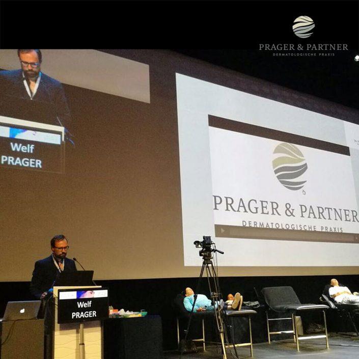Dr. Welf Prager erklärte vor der Live-Demo erst einmal seine Behandlungsweise und veranschaulichte es anhand einer Präsentation. AMEC live Visage, Monaco